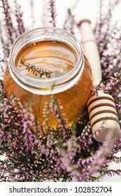 herbal honey in jar with fresh heather - sweet food /shallow DOF/