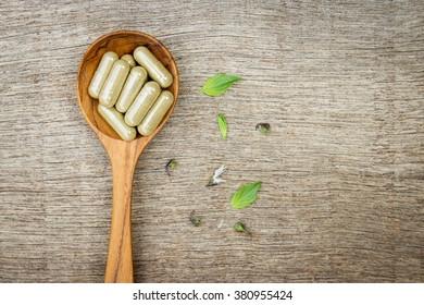 Herbal medicine in capsules from sweet basil