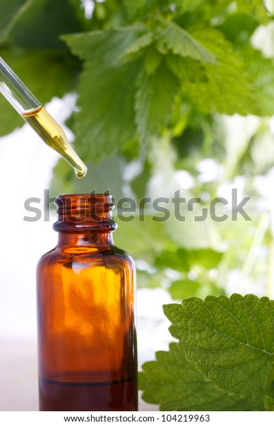 Herbal medicine with dropper bottle and mints