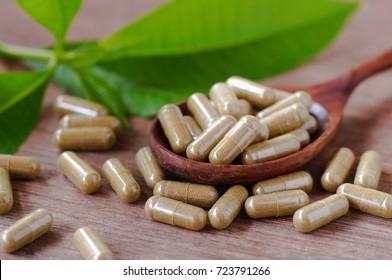 Herbal medicine on wood spool with leaf on wood table
