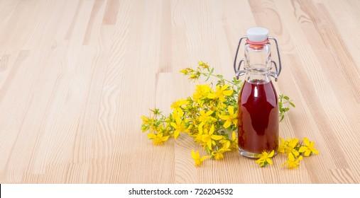 Herbal Oil with fresh, flowering St. John's wort
