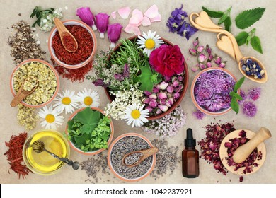 Herbal plant medicine preparation with herbs and flowers, aromatherapy essential oil bottle and mortar with pestle on hemp paper background. Natural healthcare concept.Top view.