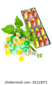 Herbal remedy alternative medicine. Chamomile flowers and nettle with medication isolated on white background