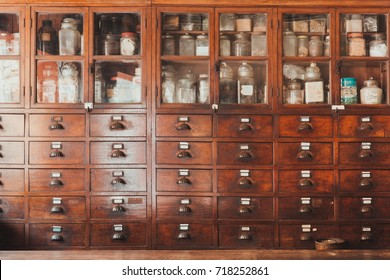 herbal shop or Chinese herb store dried wooden antique cupboard for medical drug storage