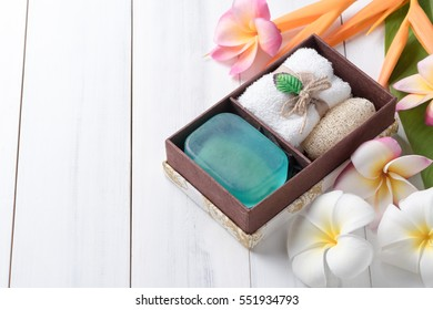 Herbal soap gift box on white wood background, healthy care concept