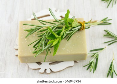 Herbal soap with rosemary and mint leaves bouquet