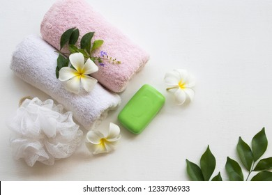 herbal soap with terry cloth health care for body skin cleaning to a bath with flower frangipani on background white