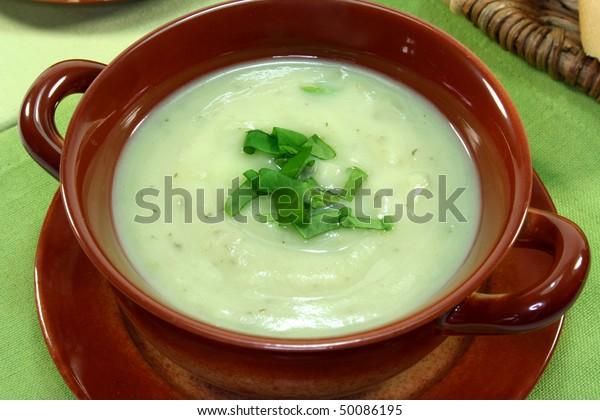 Herbal soup garnished with fresh sorrel