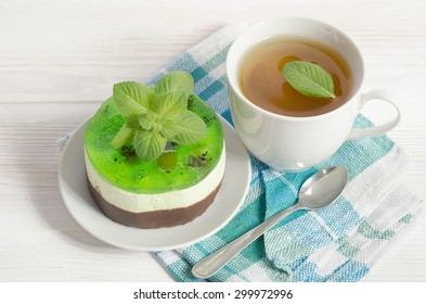 herbal tea with cake on white wooden table