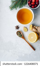 Herbal tea for colds and flu. Healthy beverage made from lemon, ginger, spices and herbs. Vertical photo.