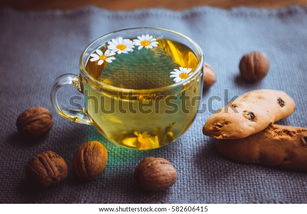 herbal tea cookies and nuts on the table