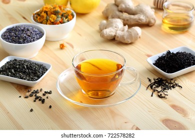 herbal  tea cup  in glass on wooden kitchen table