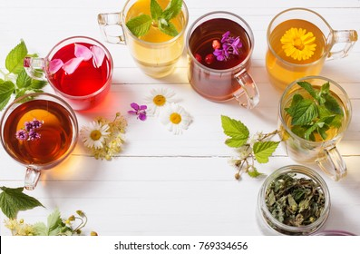 herbal tea in cups on a white background