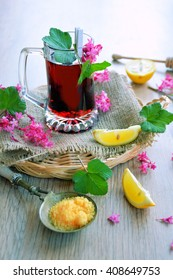 Herbal tea with currant .with lemon and sugar