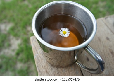 Herbal Tea with Daisy in a Stainless Mug, outdoor, trip and travel