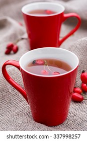 Herbal tea with dog roses in red cup