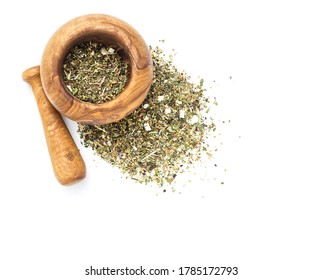 Herbal tea or dry herb in mortar and pestle, top view, on white background