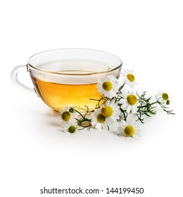 Herbal tea with fresh chamomile flowers on white background