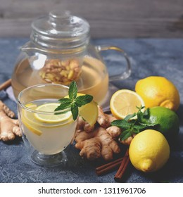 Herbal tea with ginger, mint and lemons, healthy vitamin drink, square image