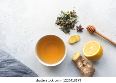 Herbal tea. Lemon, ginger, honey and herbs on concrete table. Top view.