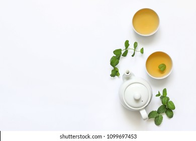 Herbal tea from mint and other herbs on a white background. The view from the top. Copy space