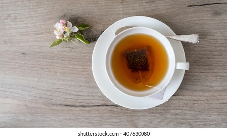 Herbal tea over wooden background, top view