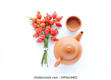 herbal tea with rose hips isolated on white, Medicinal plants and herbs composition
