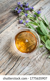 Herbal tea with sage on a wooden background