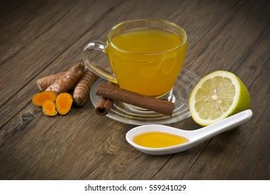 herbal tea with turmeric powder,slices and cinnamon