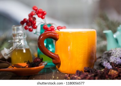 Herbal tea from the viburnum decoction of red sea buckthorn berries and thyme in mug the village on a wooden table