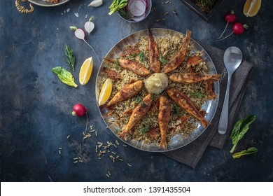 Herbed rice with fried fish, persian new year dish