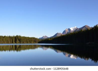 Herbert Lake reflections near Lake Louise, Alberta in the Canadian Rockies