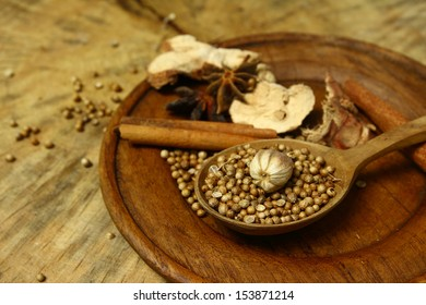 Herbs  aromatic ingredients  natural food additives on grunge wooden board