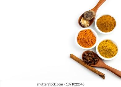 Herbs, cinnamon sticks and spice powder on white background.