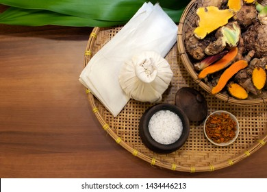 Herbs ingredients in bamboo basket for override the salt pot compress top view, Thai traditional medicine hot compress therapy. Thai herbal for health massage alternative medicine.