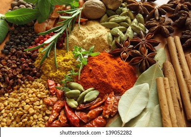 Herbs and spices composition. Cooking ingredients on a ceramic tabletop.