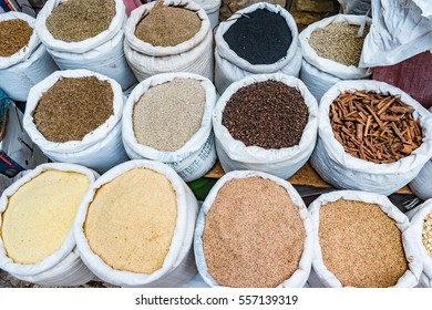 Herbs, spices and condiments on the eastern market. Tropical marketplace with sacks full of food ingredients