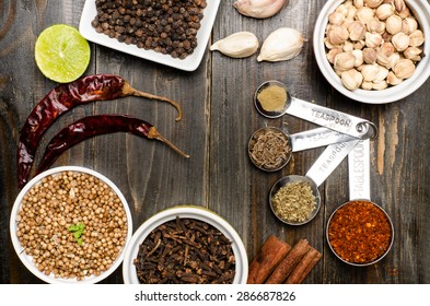 Herbs and spices, food seasoning on wooden background