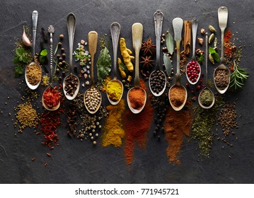 Herbs and spices on graphite background