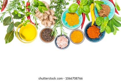 Herbs and spices on white table background. Curry, turmeric, ginger, rosemary, basil, mint. Healthy organic food