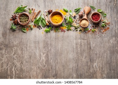 Herbs with spices on wooden board