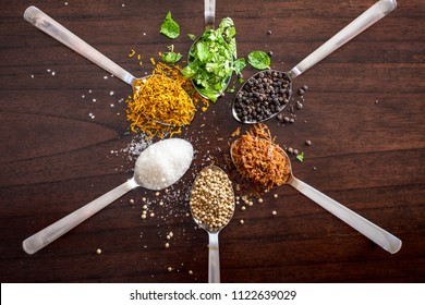 herbs and spices on wooden table top  -shot from above