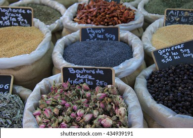 Herbs and spices at a Provencal market in France  (tags: price and product information in French)