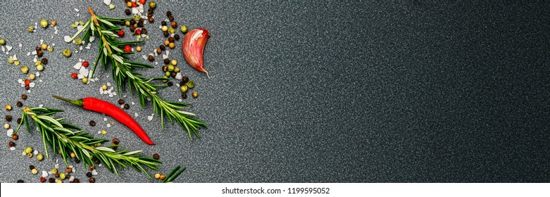 Herbs and spices top table, banner. Pepper, peperoni, salt, rosemary, garlic, on dark  background, copy space