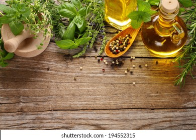 herbs,spice and oil on wooden table