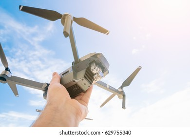 Herceg Novi, Montenegro, APRIL 18, 2017: Black drone quadrocopter in human hand against the sky