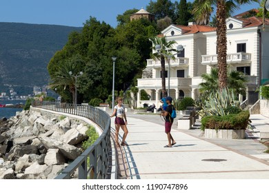 HERCEG NOVI, MONTENEGRO - August 1, 2018: The promenade is great place to go for a walk, visit the local bars, take in the locals, and enjoy the bay.