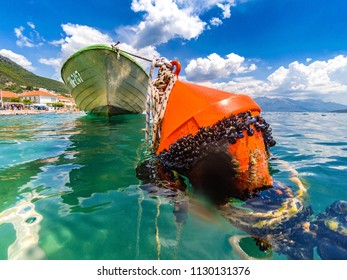 HERCEG NOVI , MONTENEGRO, July 9 2018, Action cam photo of buoy and boat used by locals for fishing
