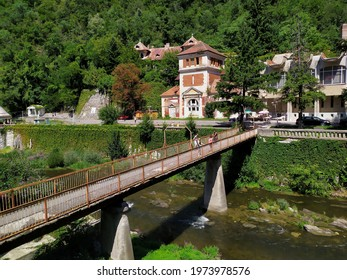 Herculane baths (Baile Herculane) -Thermal resort in Romania. Old bridge on Cerna river. Domogled National Park on a sunny day of summer - Shutterstock ID 1973978576