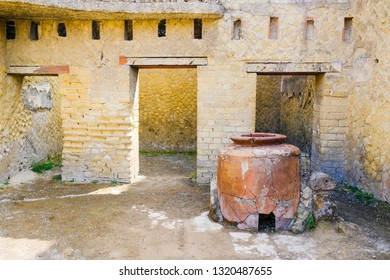 Herculaneum, ancient roman town: Wine warhouse with big amphora. Archeological site, Ercolano Italy
